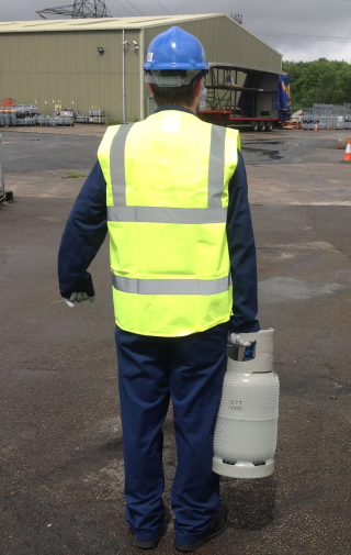 man carrying climalife cylinder